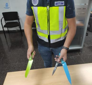 Police display the threatening weapons.