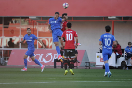 Mallorca hold on and edge closer to survival