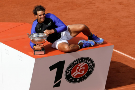 Nadal crushes weary Wawrinka to claim tenth French Open