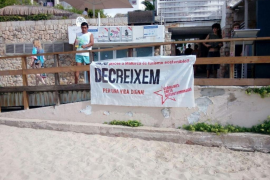 Youth agitators' banners demand a decrease in tourism