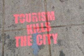 New anti-tourism graffiti condemned