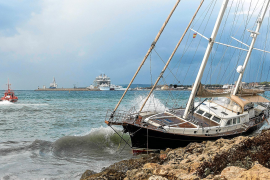Sailing vessel swept on to the rocks