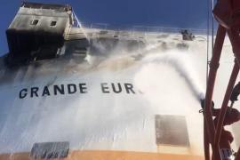 Crew evacuated from burning cargo ship