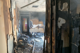 Woman rescues son from burning apartment