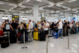 Passengers are seen at Thomas Cook check-in points at Mallorca Airport