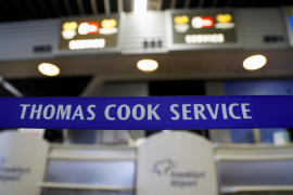 A closed Thomas Cook check-in service is pictured at the Frankfurt Airport
