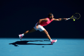 Dominant Nadal eases past Carreno Busta into fourth round