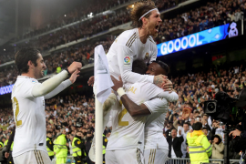 Real win 'Clasico' to reclaim La Liga lead from Barca