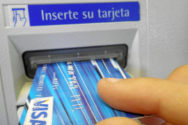 Smaller Spanish banks up stakes in big spat over ATM charges