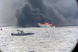 Two rescued after yacht catches fire