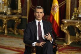 King Felipe urges unity and calm reflection