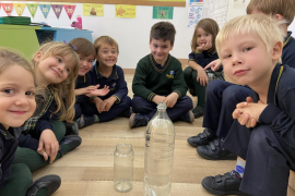 """Children in Year 1 have been investigating the terms """"half full"""" and """"half empty"""""""