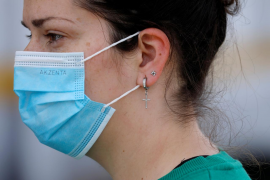 Spain lowers price cap on COVID-19 masks
