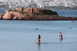 Greeks escape lockdown for the beach as winter temperatures soar