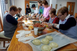 Family making Easter panades.