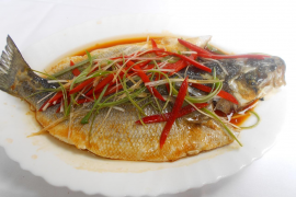 The sea bass is presented with a topping of colourful shredded vegetables
