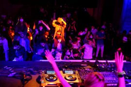 Euphoric clubbers hit dance floor again as Spain trials digital COVID-19 pass