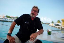John McAfee speaks during an interview in Havana