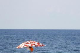 People sunbathe in Magalluf beach in Mallorca