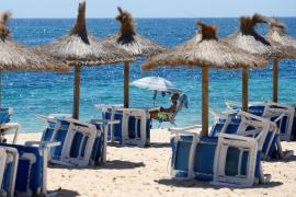 A tourist enjoys the weather at Magaluf beach
