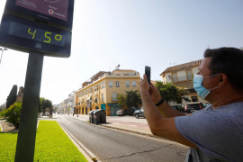Spaniards sizzle through first heatwave of the summer as temperatures reach 44 C
