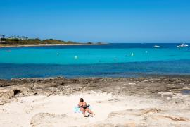A person on a beach on the Balearic Islands