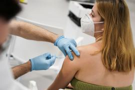 A woman receives a dose of the Moderna coronavirus disease (COVID-19) vaccine in Madrid