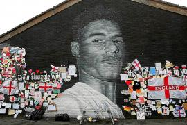 Rashford's mural is shown covered in messages of support