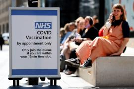 Early signs COVID-19 vaccines may not stop Delta transmission, England says