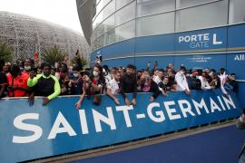 Fans await the potential arrival of Lionel Messi in Paris before his expected signing for Paris St Germain