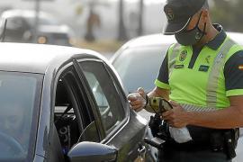 Guardia Civil officer in Mallorca conducting a breath test.