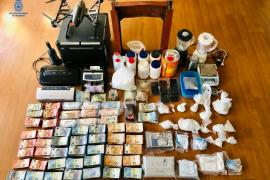 Cash and drugs seized in Palma Mallorca police operation.