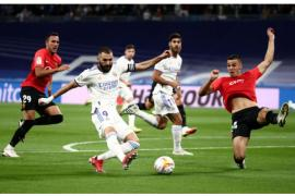 Karim Benzema taps in the opener with Gaya (29) behind.