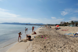 People sunbathe on El Arenal beach.