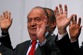 Spanish King Juan Carlos waves