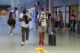 Tourists arrive at Ibiza airport