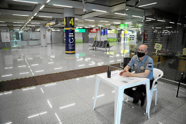 Security guard at an empty Palma Airport.