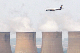 FILE PHOTO: File photograph shows a Ryanair aircraft flying above Ratcliffe Power Station as it comes into land at East Midlands Airport in central England
