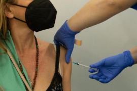 Woman being vaccinated.