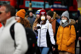 People wearing masks, London.