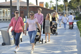 Tourists in May 2019 getting ready to start the summer season in Puerto Alcudia