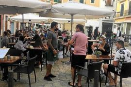 Customers on a terrace in Palma.