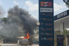 Car on fire at petrol station.
