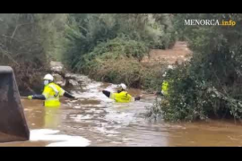 The firefighters rescued a woman who was trapped in her vehicle due to heavy rainfall
