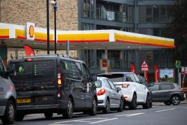 Vehicles queue to refill outside a fuel station in South London