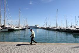 Boats are seen docked in the Port of Palma