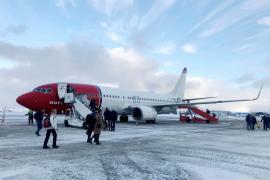 Passengers board a Norwegian Air plane in Kirkenes